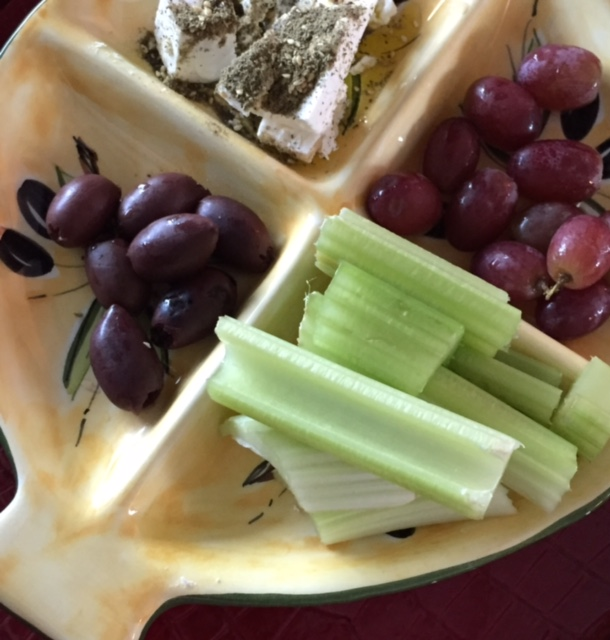 Mediterranean / Arabic fusion breakfast of Feta with Zaatar and olive oil, Kalamata olives, celery and grapes.