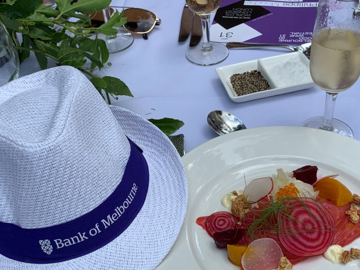 Entree produced by Philippe Mouchel. Beetroot-cured salmon with fennel salad.